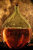 Armagnac in glass demijohn