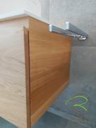 Waschtischunterschrank in Eiche massiv mit 2 Schubladen mit integrierter 28° Griffleiste von Schreinerei Holzdesign Ralf Rapp in Geisingen, Waschbeckenunterschrank in Eiche Massivholz mit Handtuchhalter