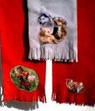Schals mit Hunde- oder Pferdemotiven gibt's natürlich auch; am besten einfach vorbeikommen und aussuchen