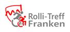 Zwei stilisierte Rollstuhlfahrer vor stilisiertem Franken-Wappen in den Farben rot und grau, Text Rolli-Treff Franken