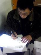 仕事中の内田和宏先生の画像
