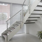 Treppen Ideen in Holz HPL und Stahl mit Glas und Edelstahl