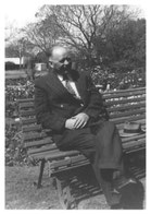 Dr. Mac sitting on a bench in the garden of the Sanctuary