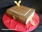 Harry Potter book birthday cake with snitch