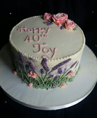 Buttercream lavender birthday cake with hand piped buttercream flowers