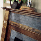 A wood fireplace with blue porcelain tile mosaic accents