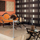 Black, grey, and white ceramic wall tiles in a room with orange accents