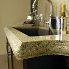 Solid surface Cambria quartz countertop with a fancy edge detail in a kitchen