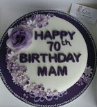 Purple, lavender and white ladies 70th Birthday cake with sugar flowers
