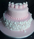 baby girls pink Christening cake decorated with baby blocks and flowers