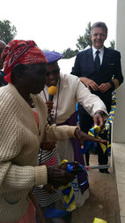 John Kaheni's grandma and Anglican Bishop Timothy Ranji cutting the ribbon, observed by Fokko Doyen
