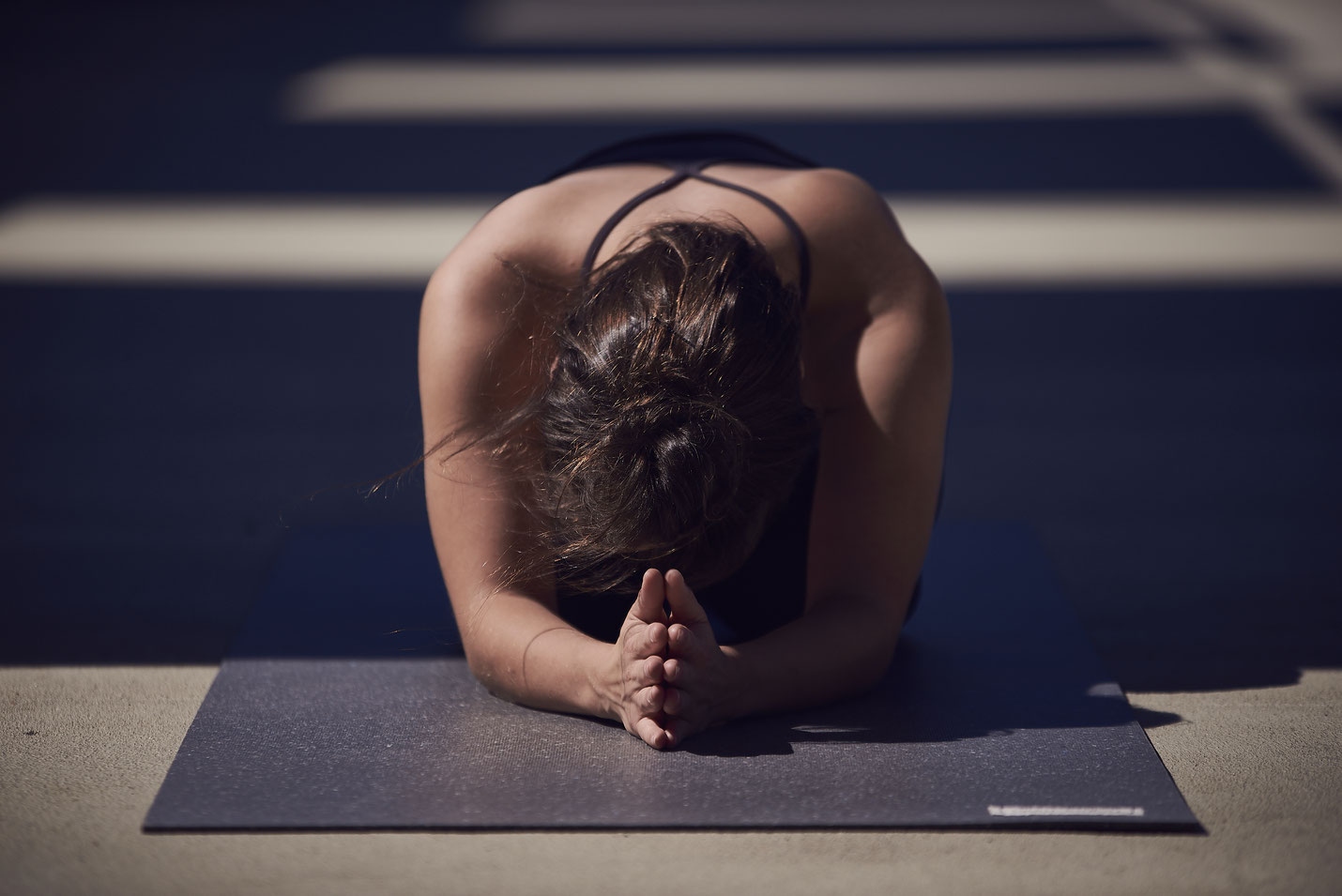 Example for an asana on the dark recycled hejhej-mat yoga mat: prayer pose.
