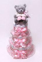 Нежный тортик из подгузников - подарок на рождение девочки.