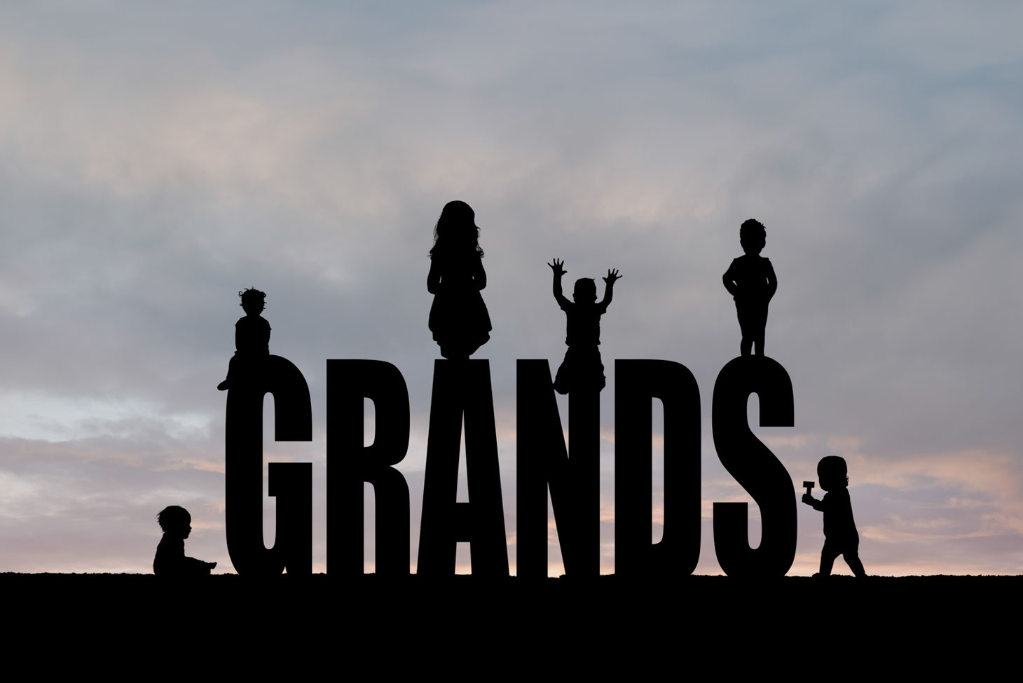 silhouettes of 6 kids on the letters GRANDS. Sky is blue, grey, and pink.