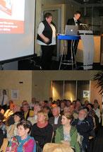 Begrüßung von Frau Asorony durch Ralf Reichenbach und interessierte Zuhörer in der Schalterhalle der Volksbank Bruhrain-Kraich-Hardt.