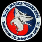 Logo des Taekwondo Blue Sharks Wiesbaden, TG Schierstein 1848 J.R., Erol Alp. Ioannis Lerakis, eine Freunschaft.