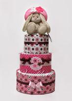 Стильный торт из памперсов и пелёнок розовый с шоколадом.