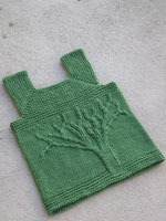 A green child's vest with a tree design on the front