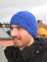 Blue beanie with textured pawprints around the body