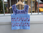 Blue child's vest with purple music notes around the body