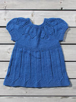 Blue dress with petal lace yoke and petal motif on the hem