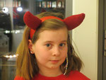 Soft stuffed knitted devils' horns on a headband