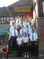 Das Foto zeigt Henning Welk (re.o.) der nach Ulrich Schammert und Heinrich Gerber der 3. Chorleiter in der damals 40-jährigen Geschichte des Chores ist.