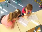 deuxième séance: les enfants, définissent le thème et commencent mettre les mots en place