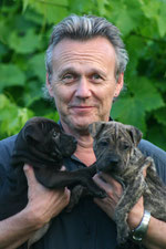 Tony with rescue puppies Moomin and George. Pic: courtesy of Sarah Fisher.