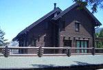 Holzhaus in Blockbauweise - Rundholzhaus - Rundbohlenhaus - Bauen und Planen