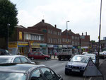 The shopping centre on Church Road looking down towards the Yew Tree roundabout. Image is courtesy of David Fisher - All Rights Reserved.