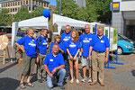 Zufriedenes Team nach einem Tag mit vielen Besuchern