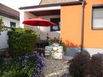 Blick auf überdachte Terrasse (Größe 10 m²) Appartement Steingarten
