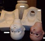 Gießform für Puppenköpfe mit Rohling und gebranntem Kopf