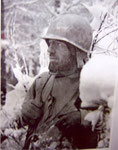 Sgt Joseph Holmes of the 35th Infantry Division in December 1944 near Wiltz
