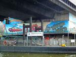 Schöne Graffiti-Sprayerei am Brückenpfeiler
