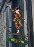 Werbeschild für die Pizzeria Arlecchino