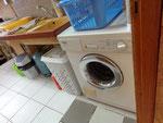 Pièce complémentaire avec lave-linge et coin cuisine
