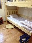 客室(10号車)① ゆったりくつろげるベッドです