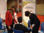 left to right: Karin van Huelsen, ND, patient, Linda Alber, ONDAMED International Affairs
