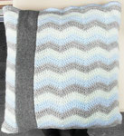 Handmade kussen in groen blauwe teinten afgewerkt met een grijze band. Te koop voor 10,00 euro