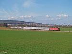 120 145 zieht am 04. März 2014 den IC 2371 nach Karlsruhe durch die Wetterau. Im Hintergrund liegt Butzbach.