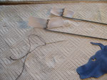 Cloth hinges sewn on to rods.