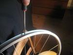 Unscrew bicycle spokes.