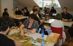 Aber auch Stone Age & 7 Wonders; im Hintergrund: Strasbourg & Im Wandel der Zeiten Würfel