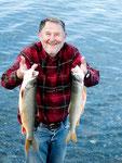 Eric mit seinem Fang (2 Seeforellen)