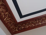 Création et réalisation d'une imitation bois palissandre, relief en rehaut en fausse dorure (bronzine) sur corniches de plafond -Particulier Paris 17-