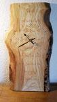 Spruchtafel mit Uhr