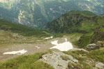 A destra la Capanna Buffalora e sotto l'Alp de Nomnom