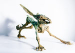 Hase laufend, Bronze teils grüne Patina